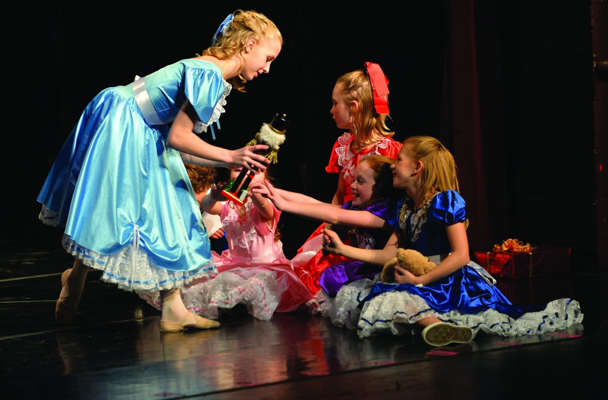 "Jordan Broyhill, playing the part of Clara, shares a scene with, from left, Maile Buschmann, Solana Brown, Hamtyn Meadows and Harper Danielson in Elevation Dance Studio's production of ""The Nutcracker."""