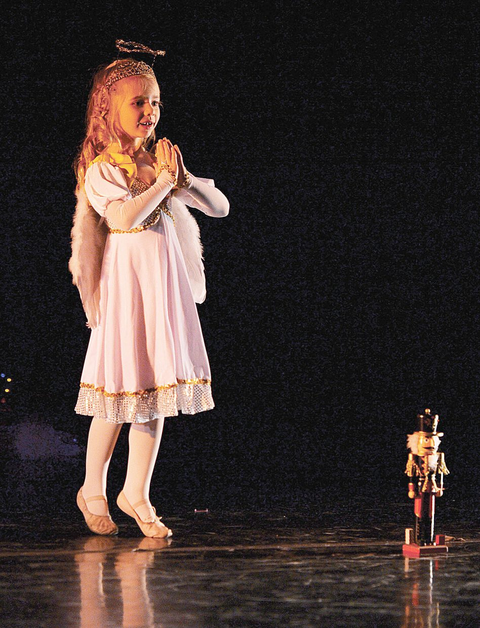 "Mia Satkiewicz plays the part of an angel in this year's production of ""The Nutcracker"" being put on by Elevation Dance Studio."