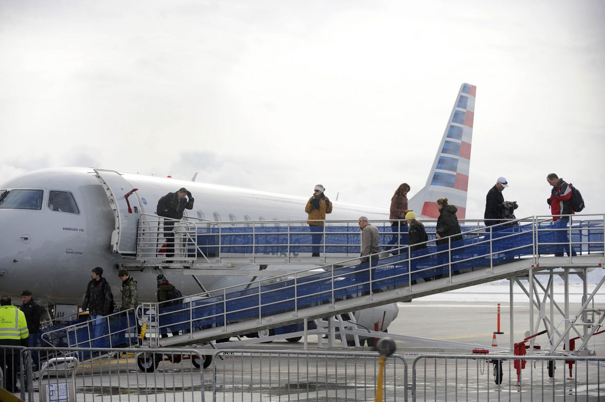 Passengers unload from an American Airlines jet arriving from Chicago on Thursday at Yampa Valley Regional Airport.