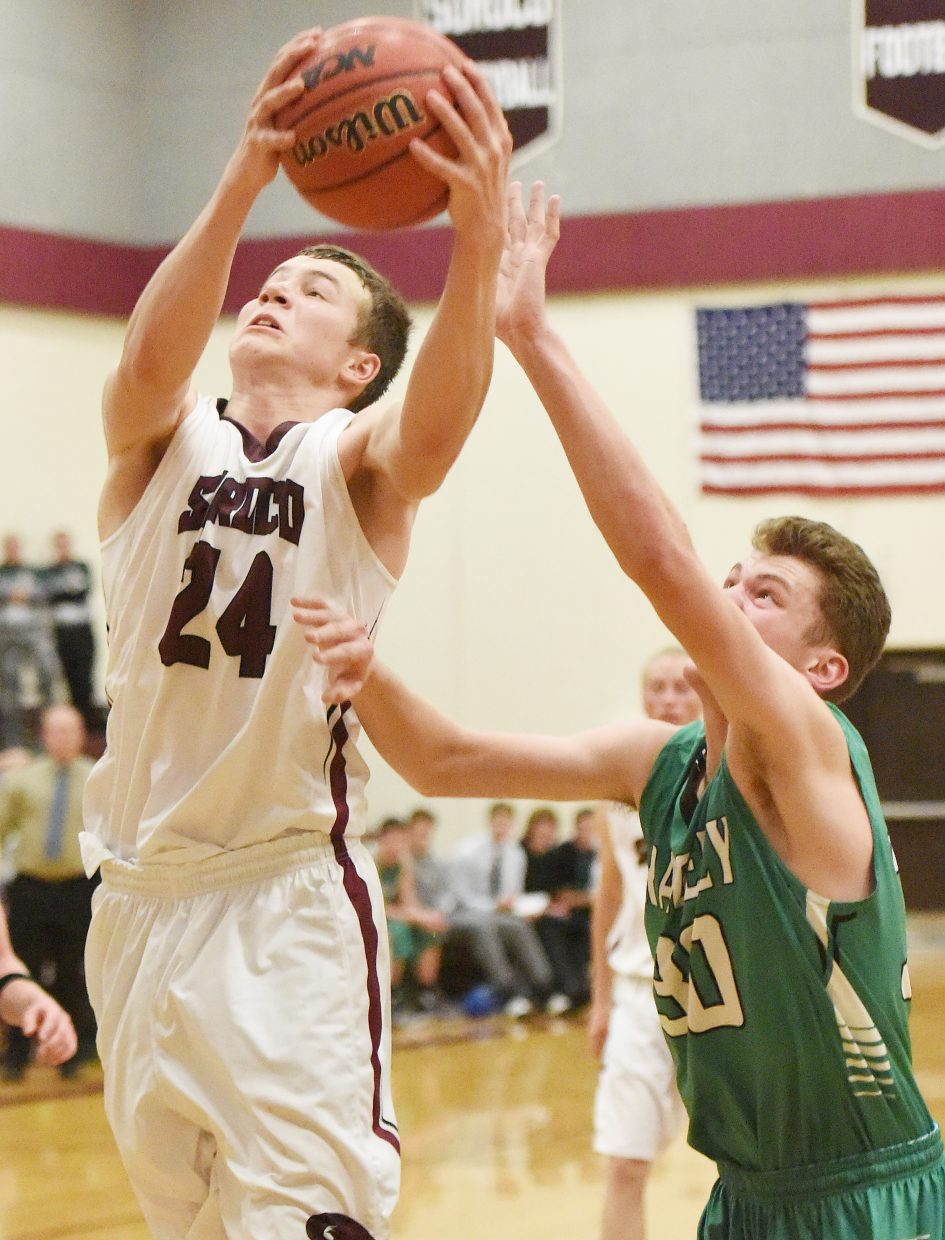 Schuyler Carlson tries to pull down a rebound Friday against Rangely. The Rams led in the second half, but couldn't hang on for the victory playing at home.