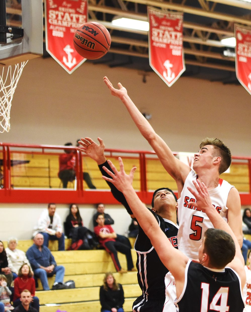Steamboat senior Jon Rinck tries to lay in a shot Saturday against Eagle Valley. Rinck finished the game with eight points, but his team lost in overtime, 45-39.