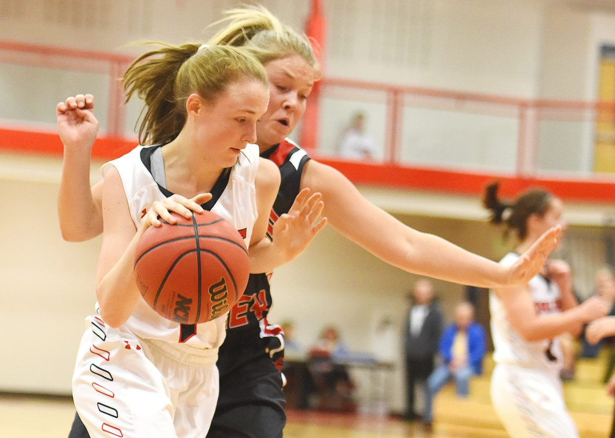 Steamboat junior Raya Duryea tries to get past an Eagle Valley defender Saturday at a game in Steamboat Springs. The Sailors lost at home, 45-31.