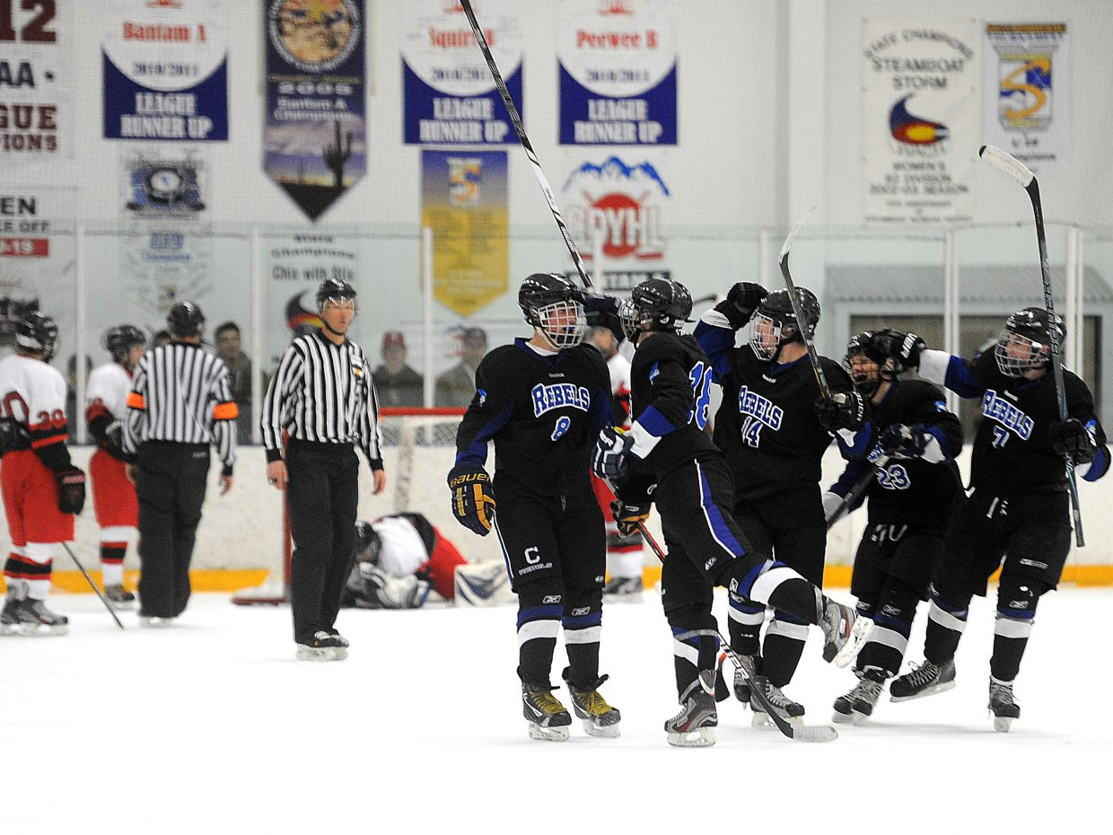 The Columbine High School hockey team celebrates Friday after an overtime goal gave it a 2-1 victory against Steamboat Springs. The Sailors will try to take out their frustrations at 1 p.m. Saturday at home against Cherry Creek.