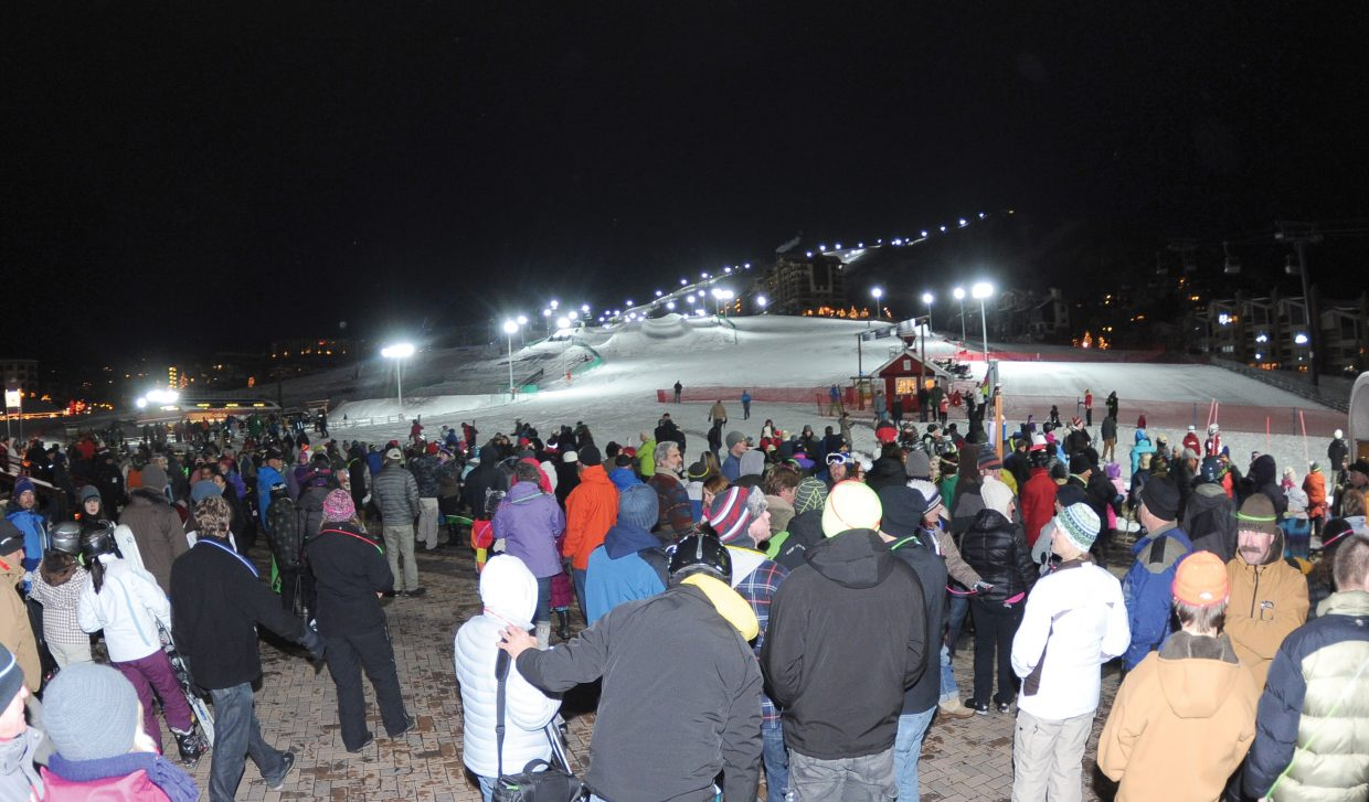 A large crowd of people looks up the slopes of Steamboat Ski Area as night skiing became a reality Friday evening at the resort.