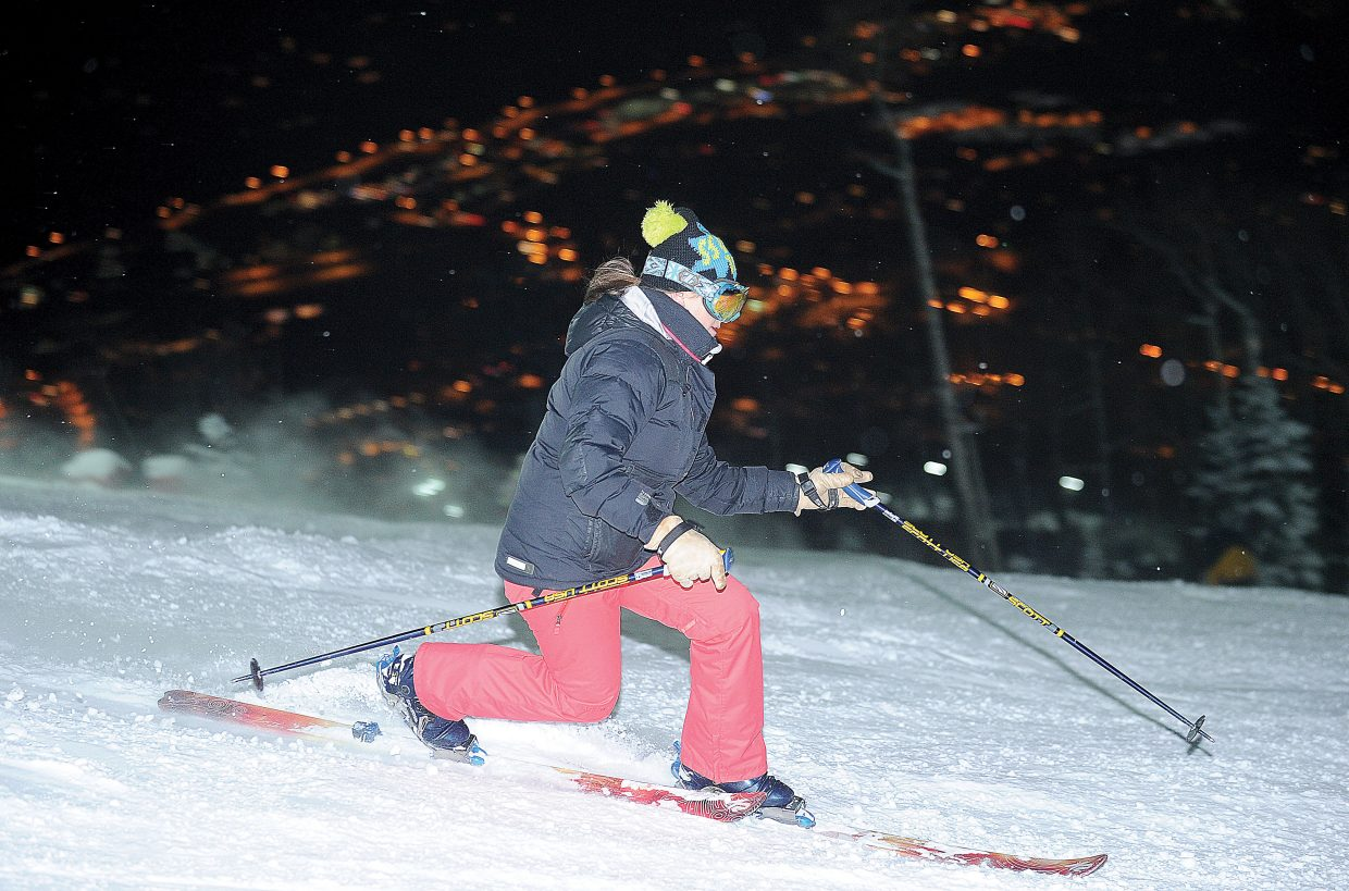 Local skier Stephanie Orozco makes a few turns Friday evening on Sitz. Steamboat Ski Area officially opened for night skiing.