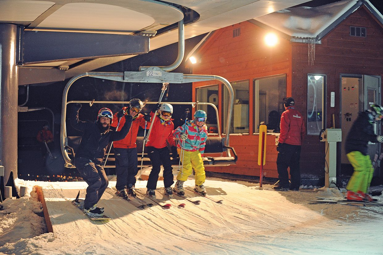 Skiers and riders celebrate Friday evening as they depart the top of the Christie Peak Express lift. Steamboat Ski Area turned on the lights and now offers night skiing for the first time.