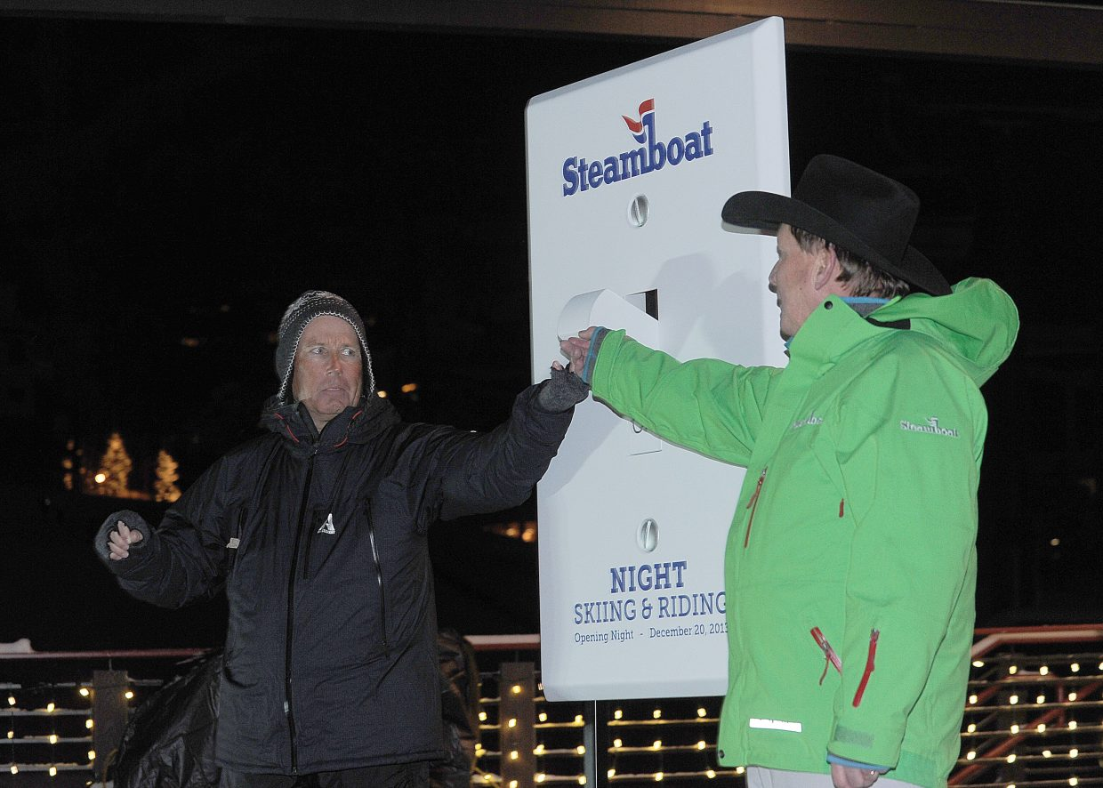 Lowell Konkel, left, and Doug Allen throw the ceremonial switch Friday, officially opening Steamboat Ski Area for night skiing.