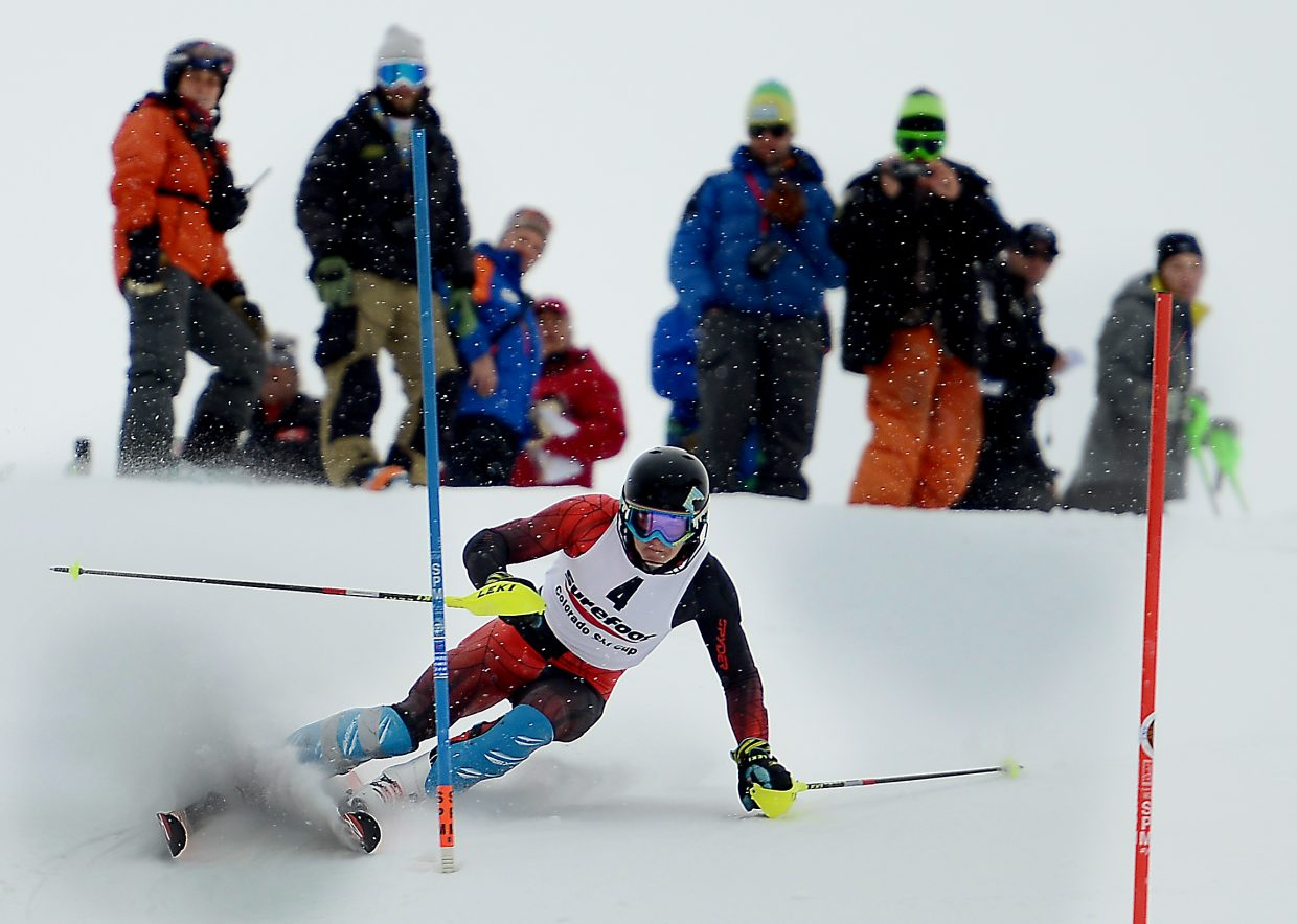 Steamboat Springs skier Nick Veth cuts down Howelsen Hill in front of a group of coaches Saturday during the first race of the three-day Holiday Classic slalom event in Steamboat Springs. Veth won the event, a welcome break for the young skier.
