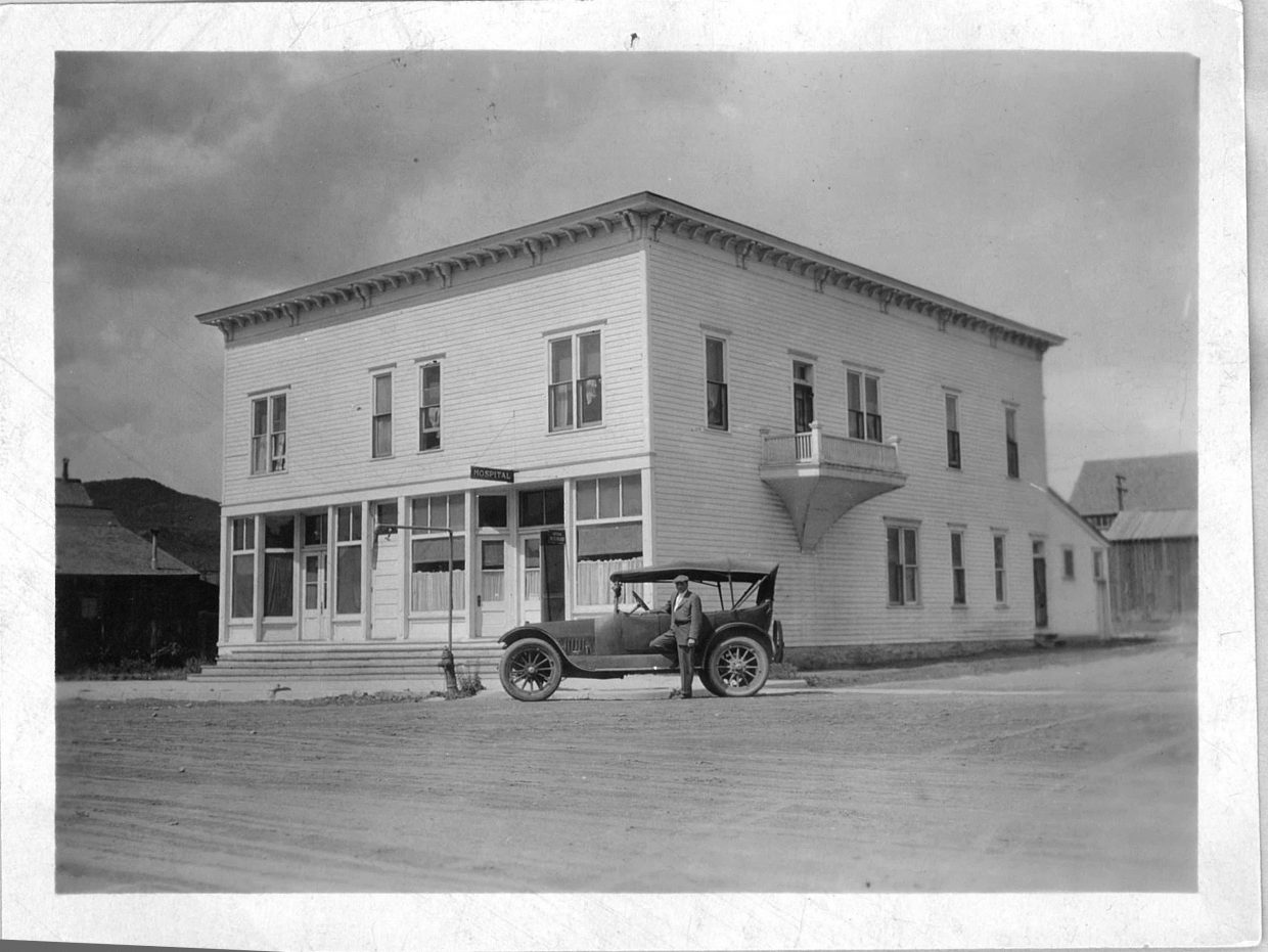 Dr. Frederick Ewing Willett stands in front of his touring car parked at the Steamboat Sanitarium on the corner of 6th and Lincoln Streets in 1915. The building was the second home of the town's hospital, from 1915 to 1921, and is today home to Old Town Pub and other businesses. Willett was one of the first to alert the community to the need for a medical facility and he owned and operated the hospital from 1914 to 1950.