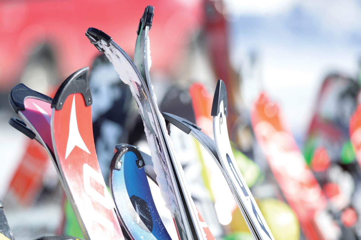 Race skis line the racks at the base of Howelsen Hill this week as young athletes test their skills on the steep-pitched face of the downtown ski area during the Holiday Classic slalom races.