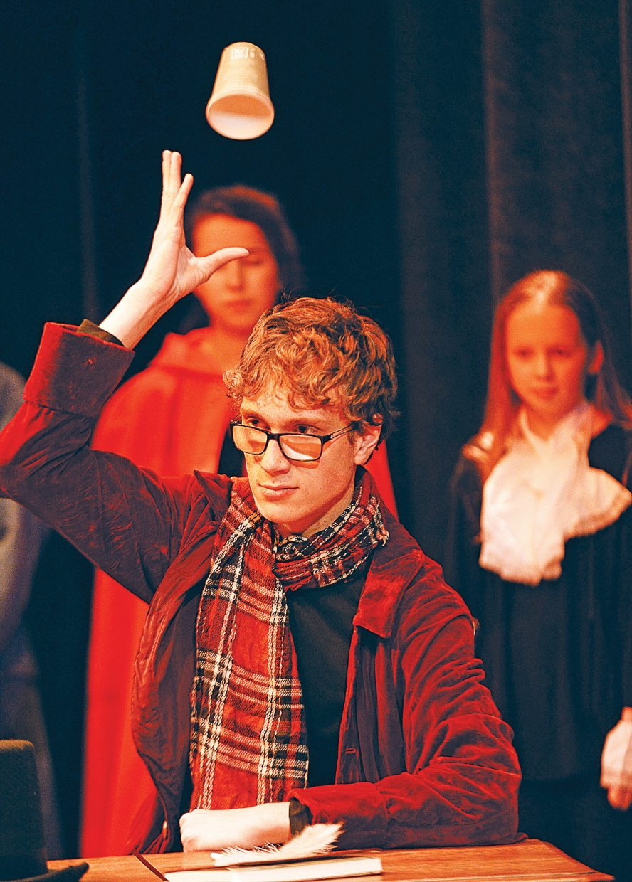 """Max Timmerman, playing the part of Ebenezer Scrooge, rehearses a scene Wednesday evening at the Chief Theater. """"Scrooge's Christmas"""" will be performed by the Chief Youth Players at 7 p.m. Dec. 2. 3 and 4. Tickets to the production at $15."""