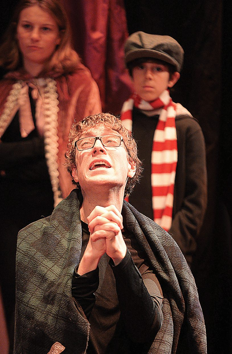 Max Timmermani, playing the part of Ebenezer Scrooge, pleads to the ghost of Marley while rehearsing a scene Wednesday evening at the Chief Theater. Scrooge's Christmas will be put on by the Chief Youth players at 7 p.m. Dec. 2-4. Tickets to the production at $15.
