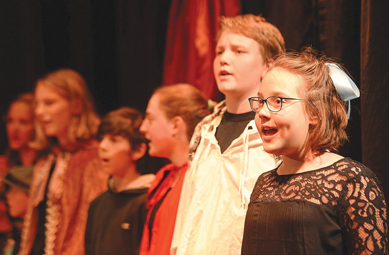 """Grace Alfone and Luke Wichelhaus sing during a rehearsal for """"Scrooge's Christmas"""" Wednesday evening at the Chief Theater. Scrooge's Christmas will be put on by the Chief Youth players at 7 p.m. Dec. 2, 3 and 4. Tickets to the production at $15."""