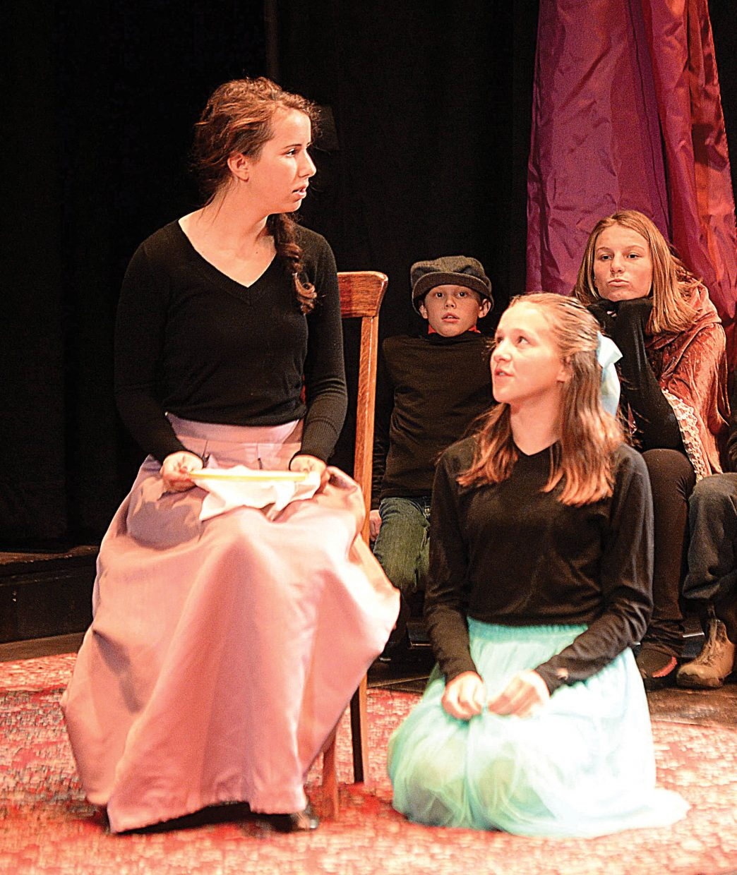 Ruth Moon, Belle, shares a scene with Josey Foote while rehearsing a scene Wednesday evening at the Chief Theater. Scrooge's Christmas will be put on by the Chief Youth players at 7 p.m. Dec. 2-4. Tickets to the production at $15.