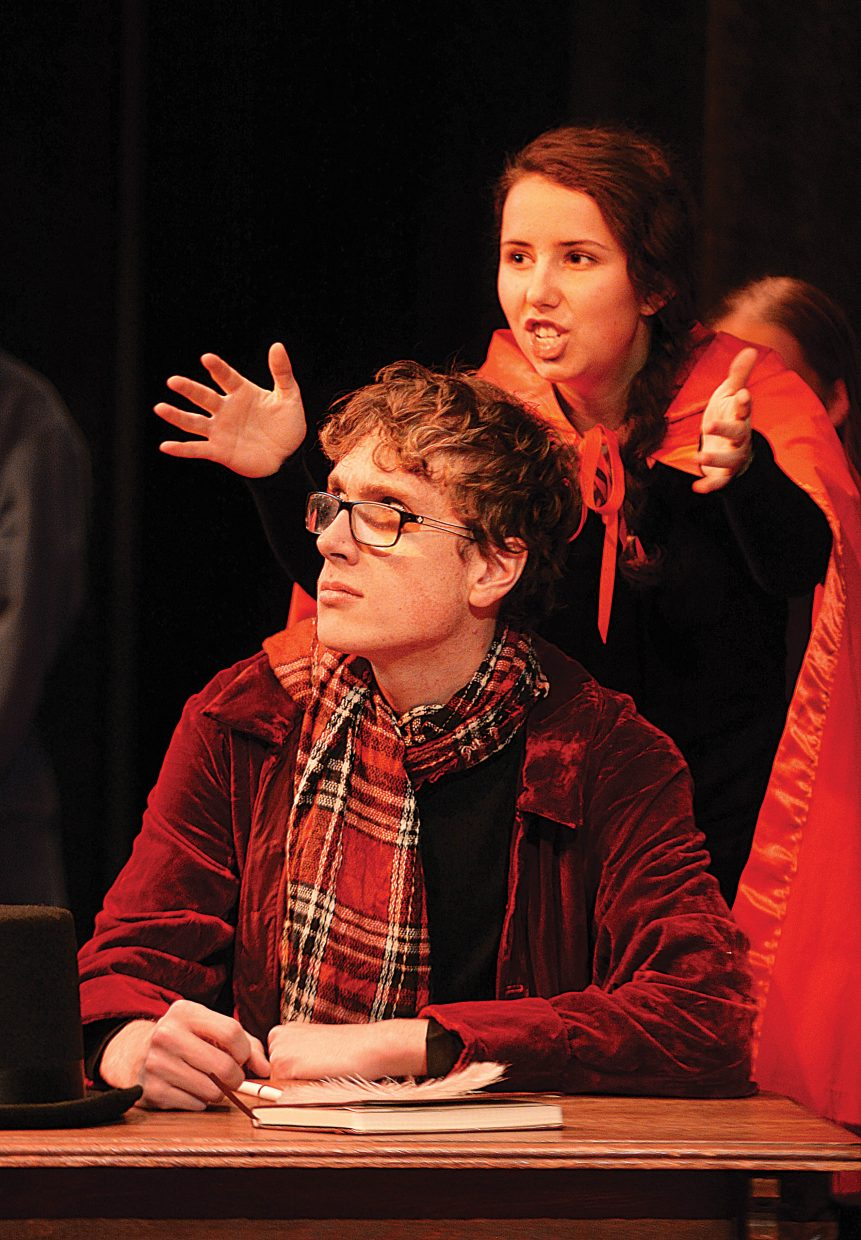 Max Timmerman, playing the part of Ebenezer Scrooge, shares a scene with Ruth Moon while rehearsing a scene Wednesday evening at the Chief Theater. Scrooge's Christmas will be put on by the Chief Youth players at 7 p.m. Dec. 2-4. Tickets to the production at $15.