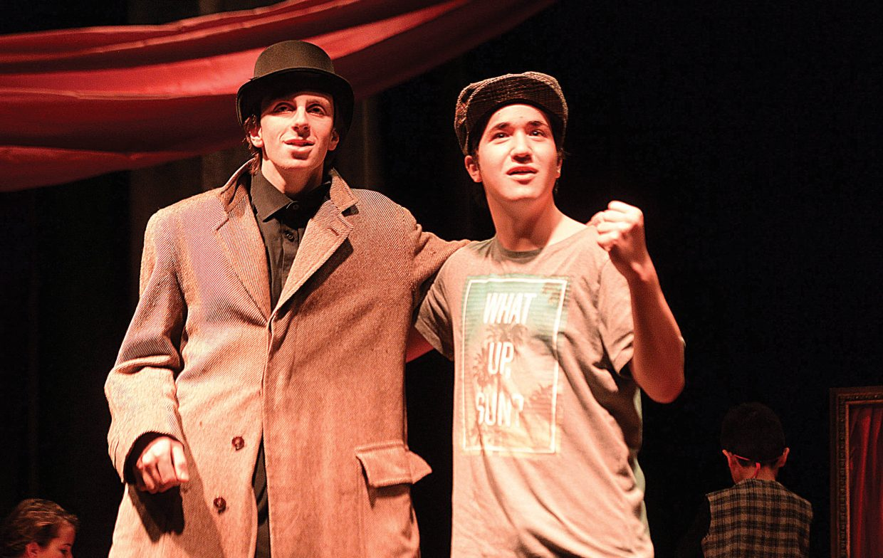Max Timmerman,, playing the part of Ebenezer Scrooge, shares a scene with Nickolas Campanelli while rehearsing a scene Wednesday evening at the Chief Theater. Scrooge's Christmas will be put on by the Chief Youth players at 7 p.m. Dec. 2-4. Tickets to the production at $15.