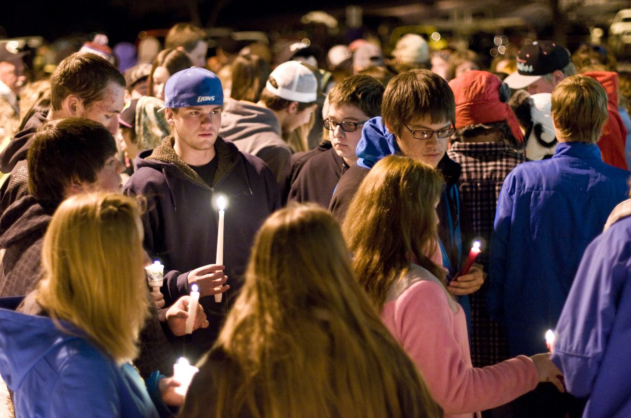 Students, friends and family of 17-year-old Tory Tovar gather in front of Moffat County High School on Sunday night for a candlelight vigil to honor and celebrate Tovar's memory.