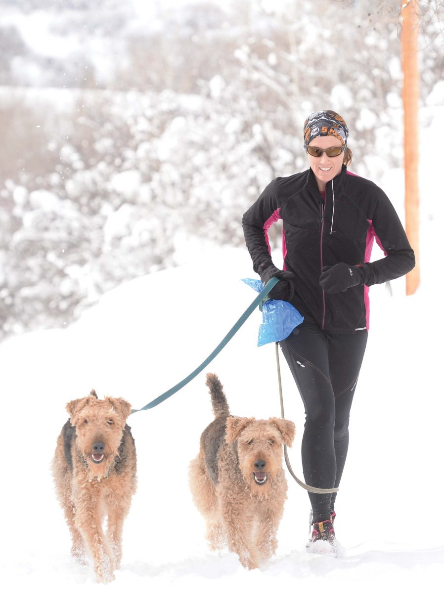 Shannon Fonger didn't let the snow stop her from taking a lunchtime run with her dogs, Stella, left, and Fozzie. It's a good thing, as the snow Steamboat residents saw Monday and Tuesday is expected to continue through mid-week.