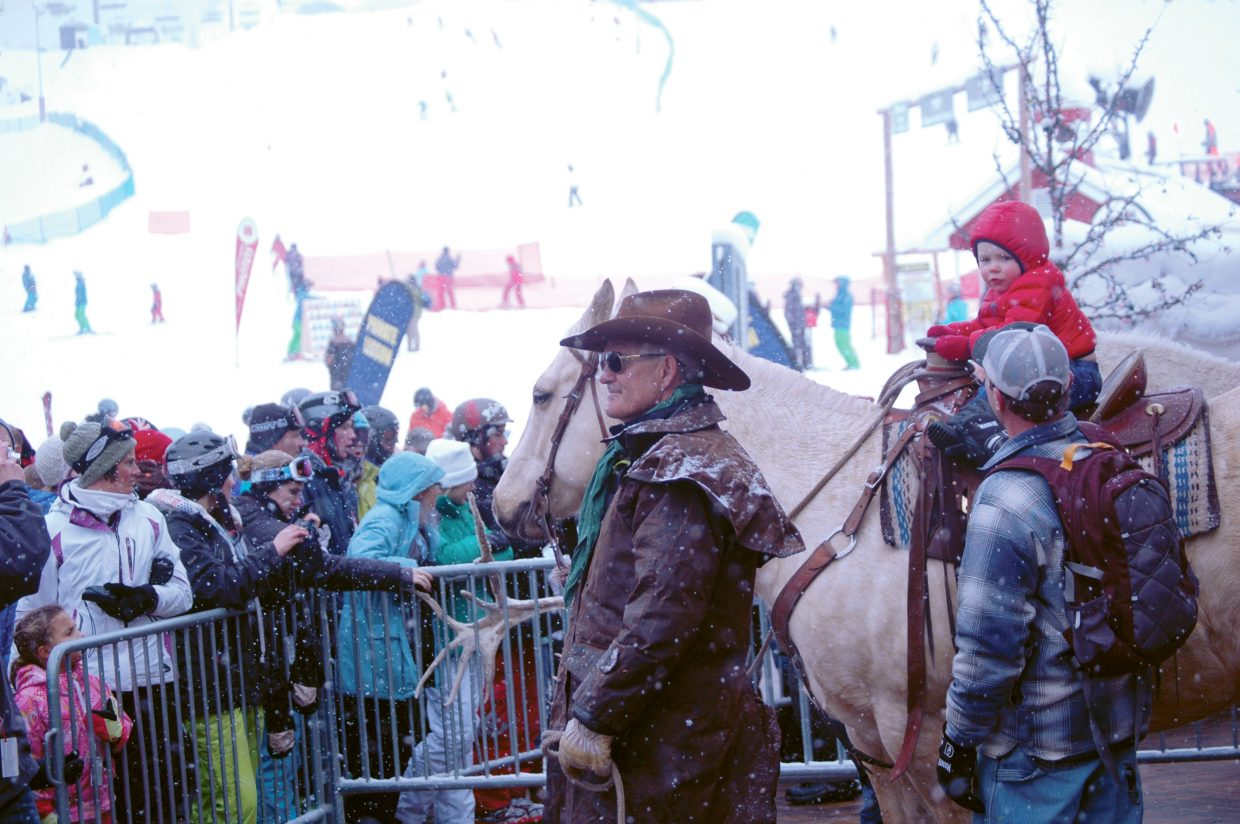 Bob Dapper keeps hold of his horse while Owen Schmidt rides Sunday at Steamboat Ski Area during the Season's Greetings event.