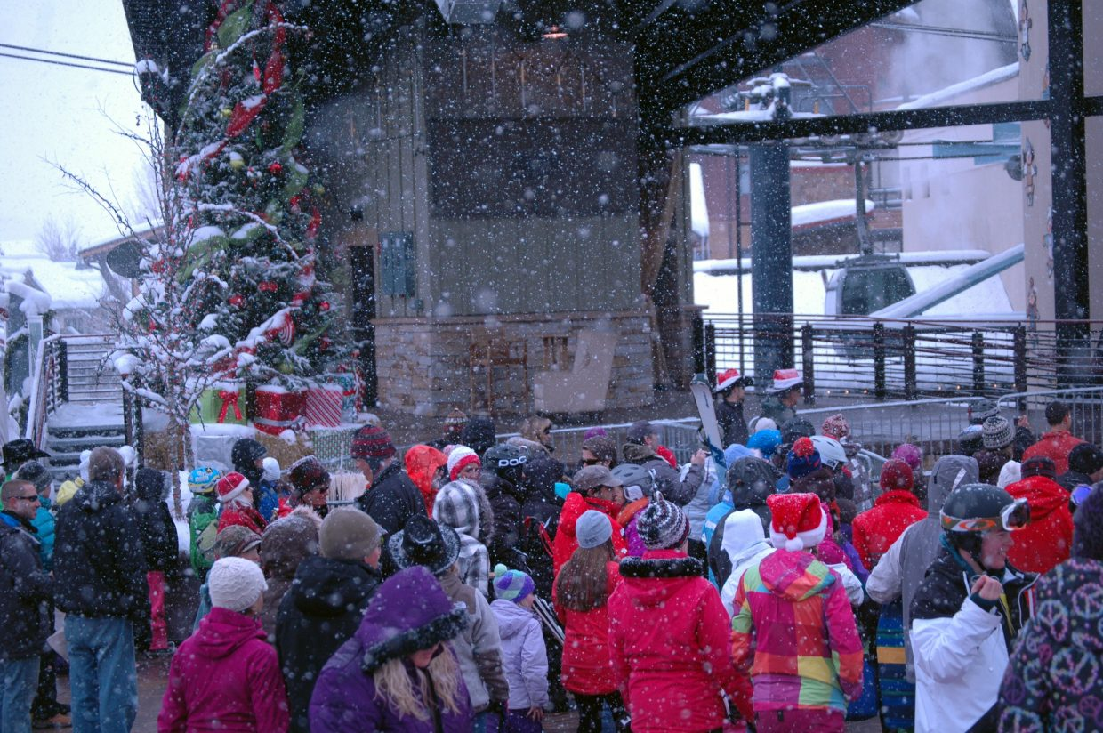 A crowd gathers at the base of Steamboat Ski Area on Sunday for the Season's Greetings event, which included cookie decorating, reindeer, Santa on horseback and photos with Santa on the Steamboat Stage.