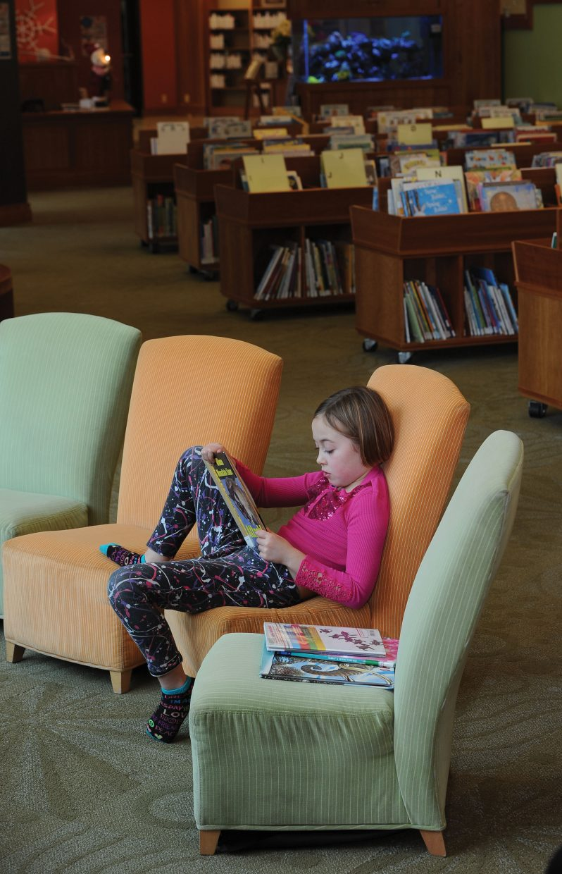 Grace George escaped the cold weather by hanging out in the Bud Werner Memorial Library on Monday afternoon in Steamboat Springs.