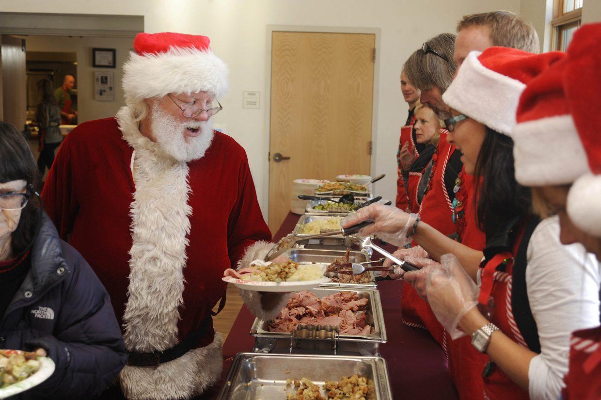 Former Steamboat Springs resident Robert Sawer fills his plate while dressed as Santa at the 2013 Steamboat Springs Board of Realtors' Community Christmas Dinner. This year's event takes place from 2 to 6 p.m. Thursday at the Steamboat Springs Community Center.