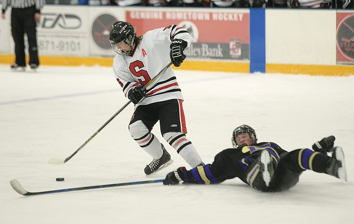 Steamboat Springs junior Luke Borgerding avoids a diving defenseman during the second period of Thursday's game against Fort Collins. The game was tied at 1-1 at the end of regulation, but Fort Collins' Blake Miller scored with just over a minute remaining to win the game 2-1