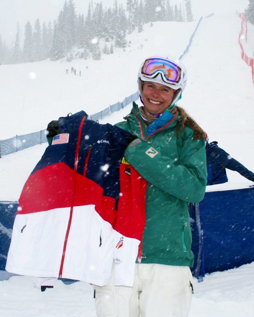 Lane Stoltzner shows off her U.S. Ski Team jacket she earned by earning starts in next month's World Cup skiing events in the United States. Stoltzner has been on the team's development squad for four years and hopes to move up to the full team soon.