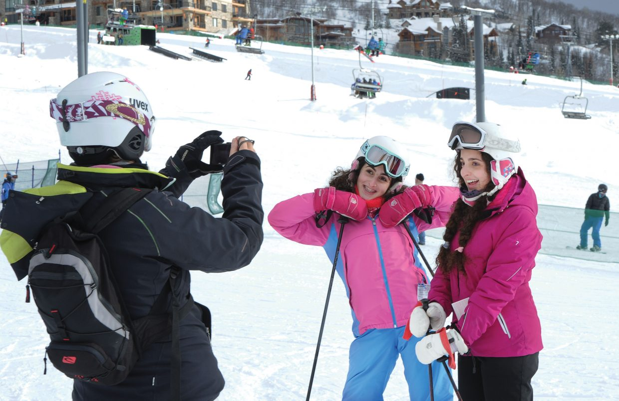 Zoe, left, and Isabella Rubins pose for a photograph Tuesday taken by their mom, Sema, at the base of Steamboat Ski Area. Skiers will have reason to smile this week as Steamboat Ski Area is expected to get another helping of snow in the next few days.