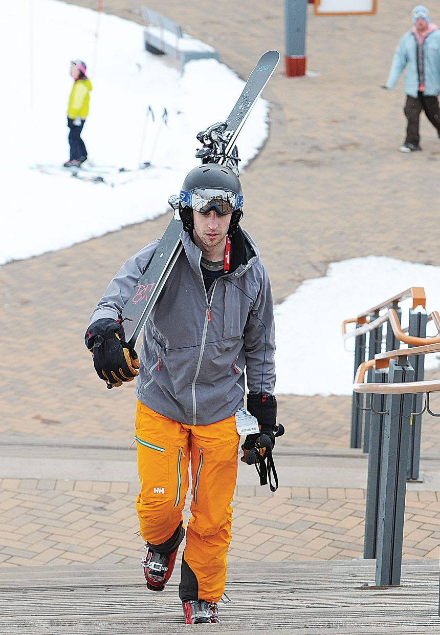 Peter Altshule, from Detroit, walks up the stairs at the base of Steamboat Ski Area on Tuesday afternoon. Skiers visiting Steamboat Springs this week should have some good conditions as more snow is expected in the next few days.