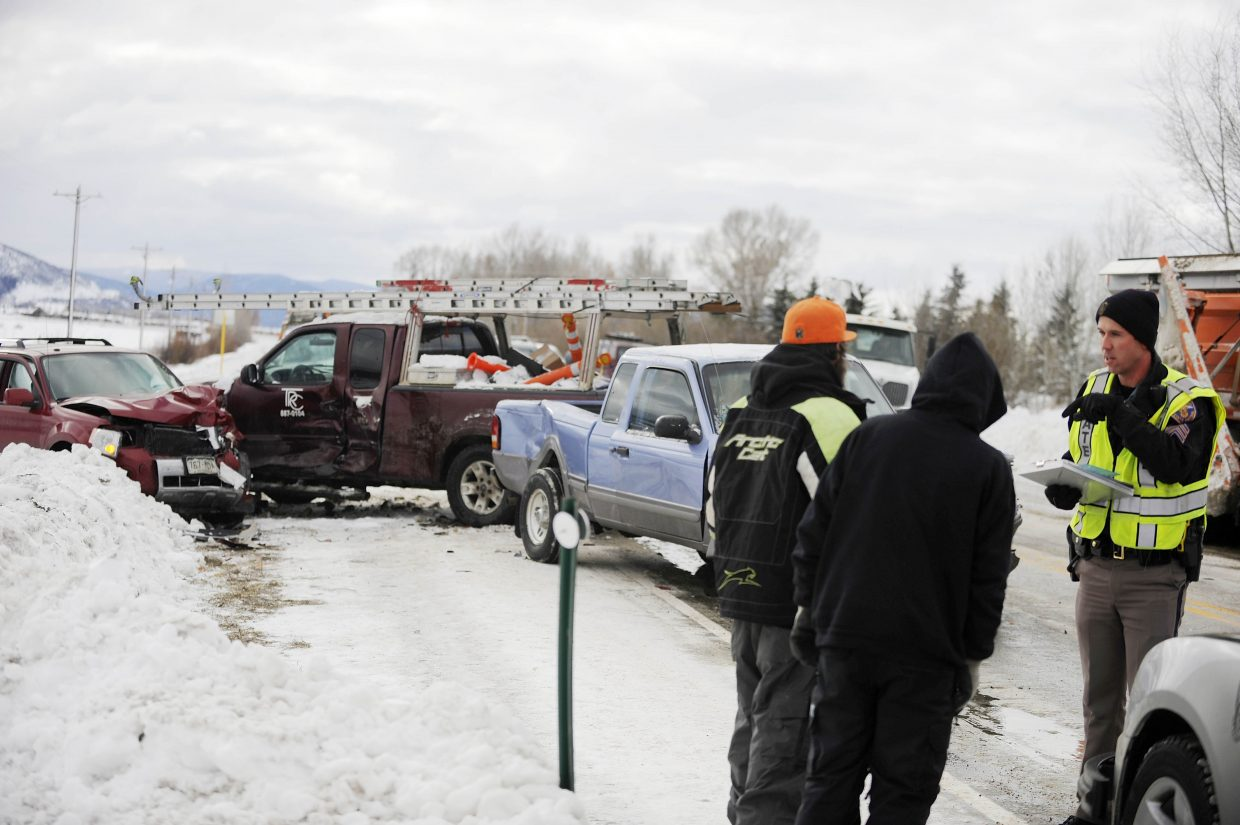 Colorado State Patrol Sgt. Scott Elliott talks to people involved in an accident Tuesday morning on U.S. Highway 40 just south of Steamboat Springs.