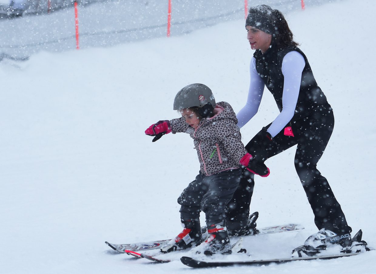 Tallie, 4, tries to get the feeling of skiing on her own as her mother, Amy Tueting, lets go during a run at Howelsen Hill in downtown Steamboat Springs on Wednesday. Despite the persistent afternoon snowfall, Tallie gave the sport her best shot with the help of her mother and her father, Brooks Tueting. The family was in town on vacation from Texas.