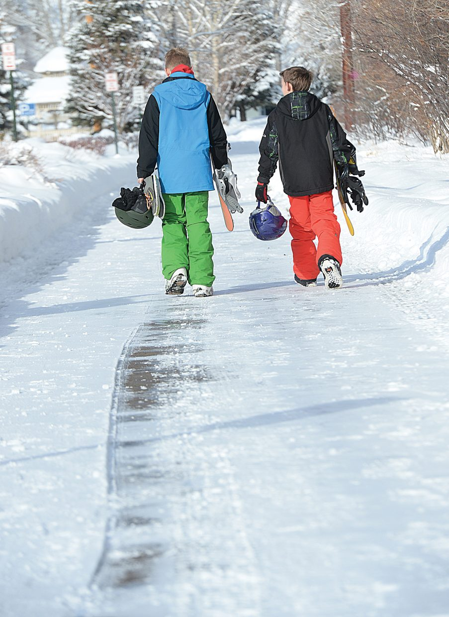 Joseph Graff, right, and Smith Dean head to Howelsen Hill Friday for the free ski day offered by the city of Steamboat Springs. The free skiing was the perfect thing for the pair of Steamboat Middle School students, who were out of school for the holiday break.