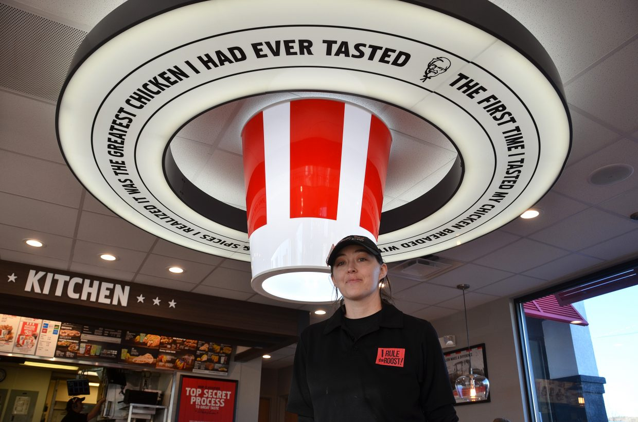 """Jennifer Jantzen took over as manager of KFC/Taco Bell in May. She's thrilled about the fast food restaurant's new look. """"It's been very exciting. People love the building,"""" she said. The redesign is the first of its kind in the nation, she said."""