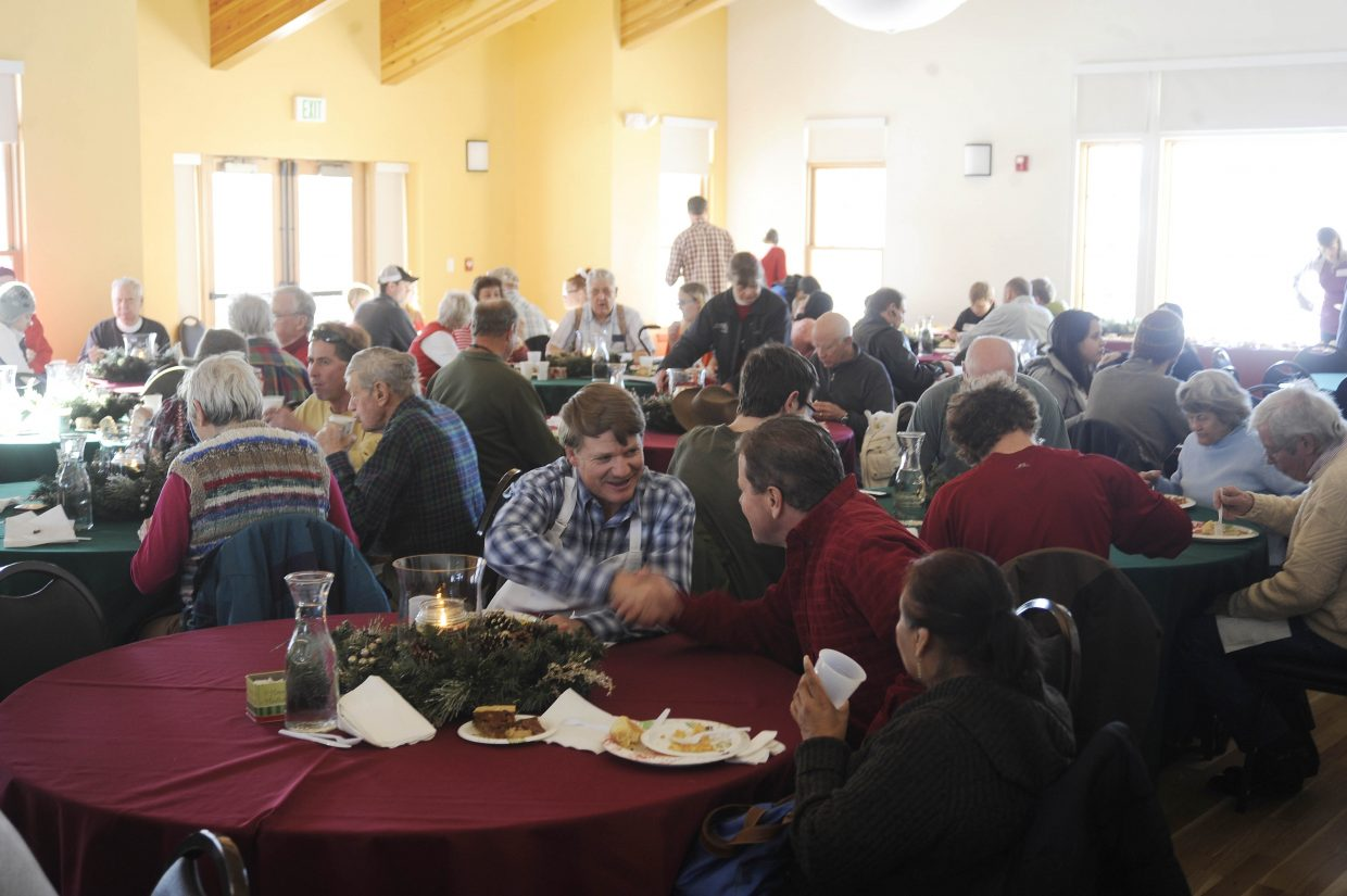People attend the Community Christmas Dinner on Wednesday at the Steamboat Springs Community Center.
