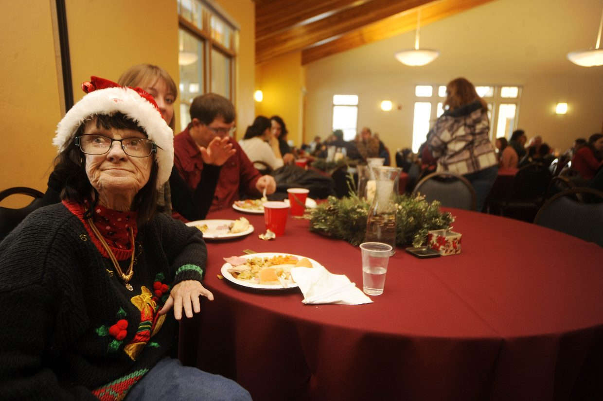 Deb Linthicum listens to music during the Community Christmas Dinner on Thursday at the Steamboat Springs Community Center.