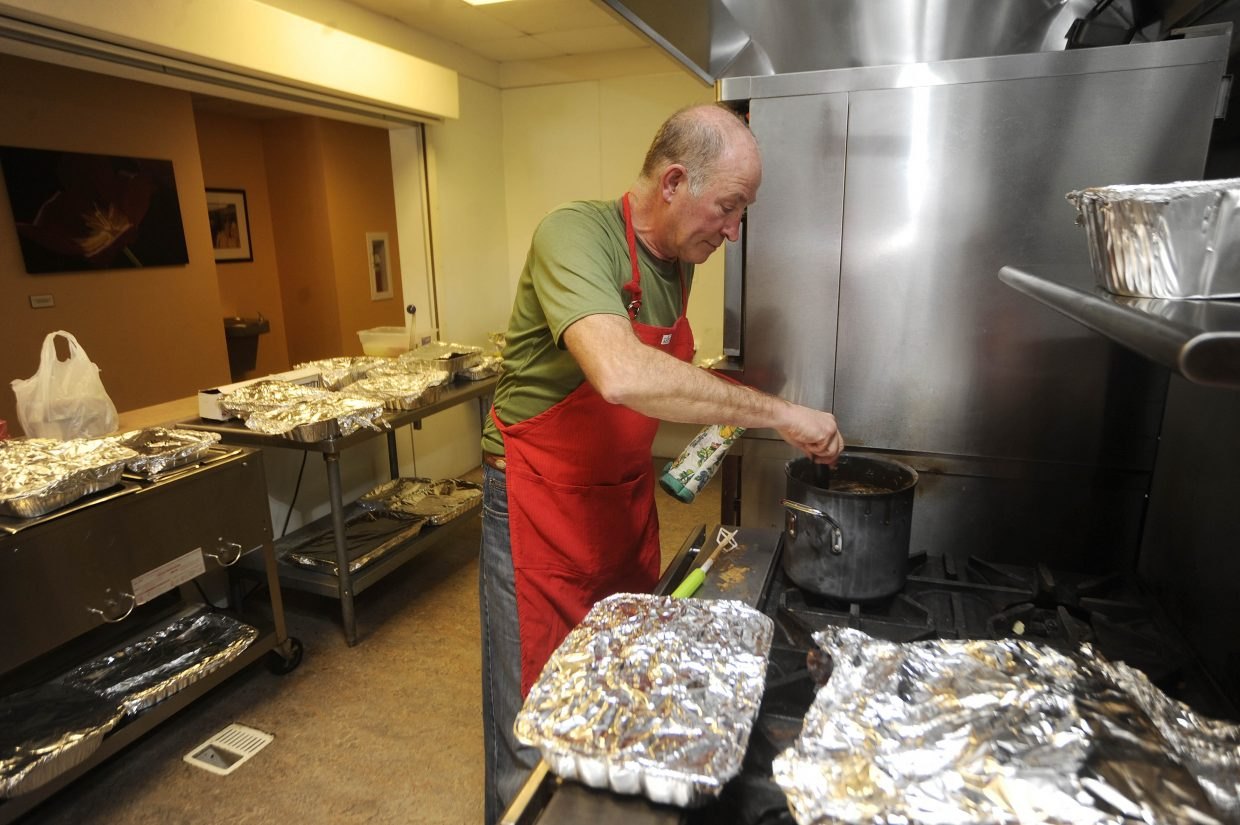 Ray Wright cooks gravy during the Community Christmas Dinner on Thursday at the Steamboat Springs Community Center.