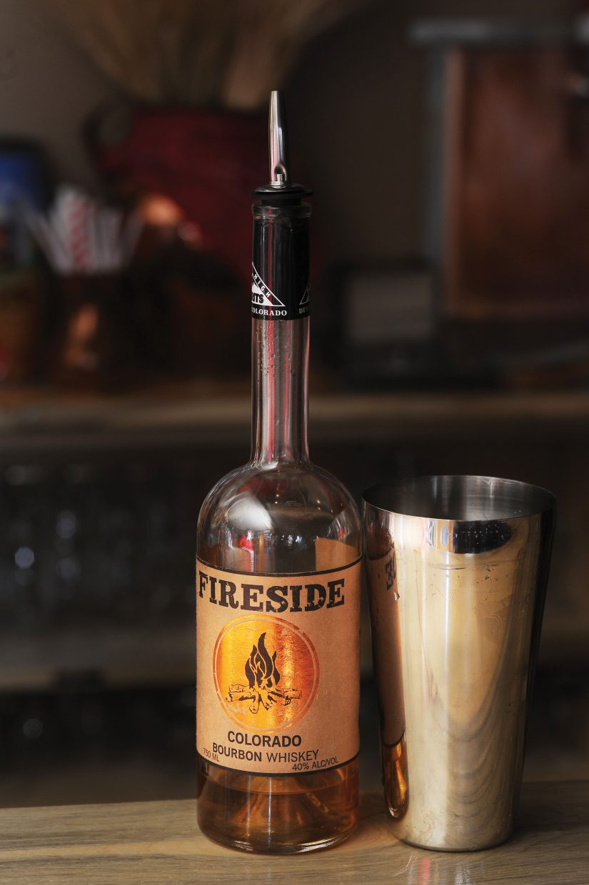 Bartender Michael Ruby uses Fireside Colorado Bourbon whiskey in a jam specialty drink at The BARley in downtown Steamboat Springs. The BARley features several Jam Drinks, this one features the choke cherry jam from Cider Fixings and the Fireside Bourbon Whiskey, also from Colorado. Ruby uses the lighter to give the drink a smoky taste.