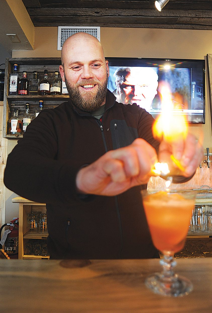Bartender Michael Ruby uses a lighter to ignite the juices from fruit while making a specialty drink at The BARley in downtown Steamboat Springs. The BARley features several Jam Drinks, this one features the choke cherry jam from Cider Fixings and the Fireside Bourbon Whiskey, also from Colorado. Ruby uses the lighter to give the drink a smoky taste.