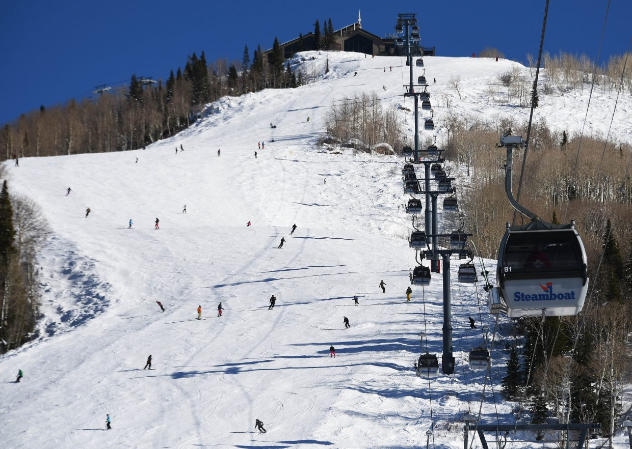 What goes up ... The gondola at Steamboat Ski Area hauls skiers and riders up Mount Werner as many fly down it on Heavenly Daze. The Christmas holiday weekend featured sun Saturday and snow Sunday.
