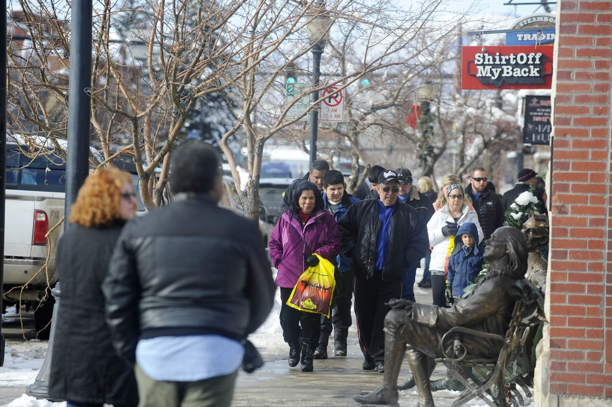 Shoppers walk down a Lincoln Avenue sidewalk on Thursday in downtown Steamboat Springs.