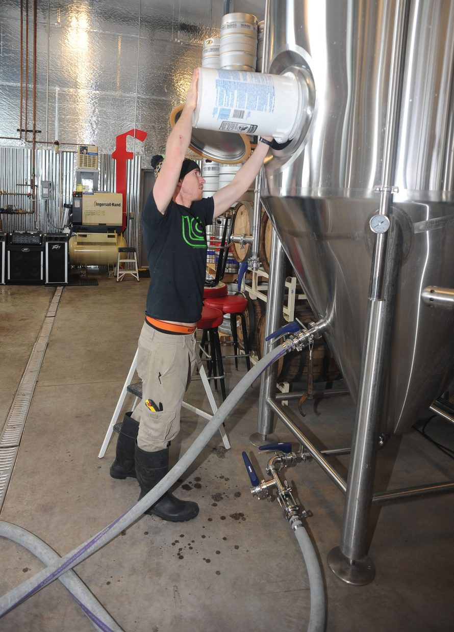 Rob Schwarz works on sanitizing a fermentor a Butcherknife Brewery in Steamboat Springs while waiting for the next step while brewing a Hefeweizen.