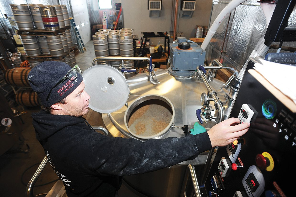 Nate Johansing, who co-owns Butcherknife Brewing Co. with Mark Fitzgerald, checks the status of a batch of Hefeweizen Bavarian ale.