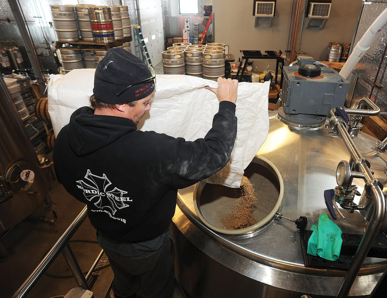 Nate Johansing, who owns Butcherknife Brewing Co. with Mark Fitzgerald, adds an ingredient to a batch of Hefeweizen.
