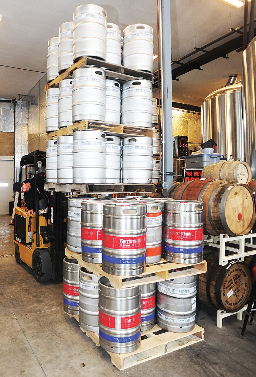 Nate Johansing, who owns Butcherknife Brewing Co. with Mark Fitzgerald, has learned that owning a craft brewery means doing a lot of different jobs. Here he moves kegs in order to make room for a new fermentor and more capacity at the small craft brewery in Steamboat Springs.