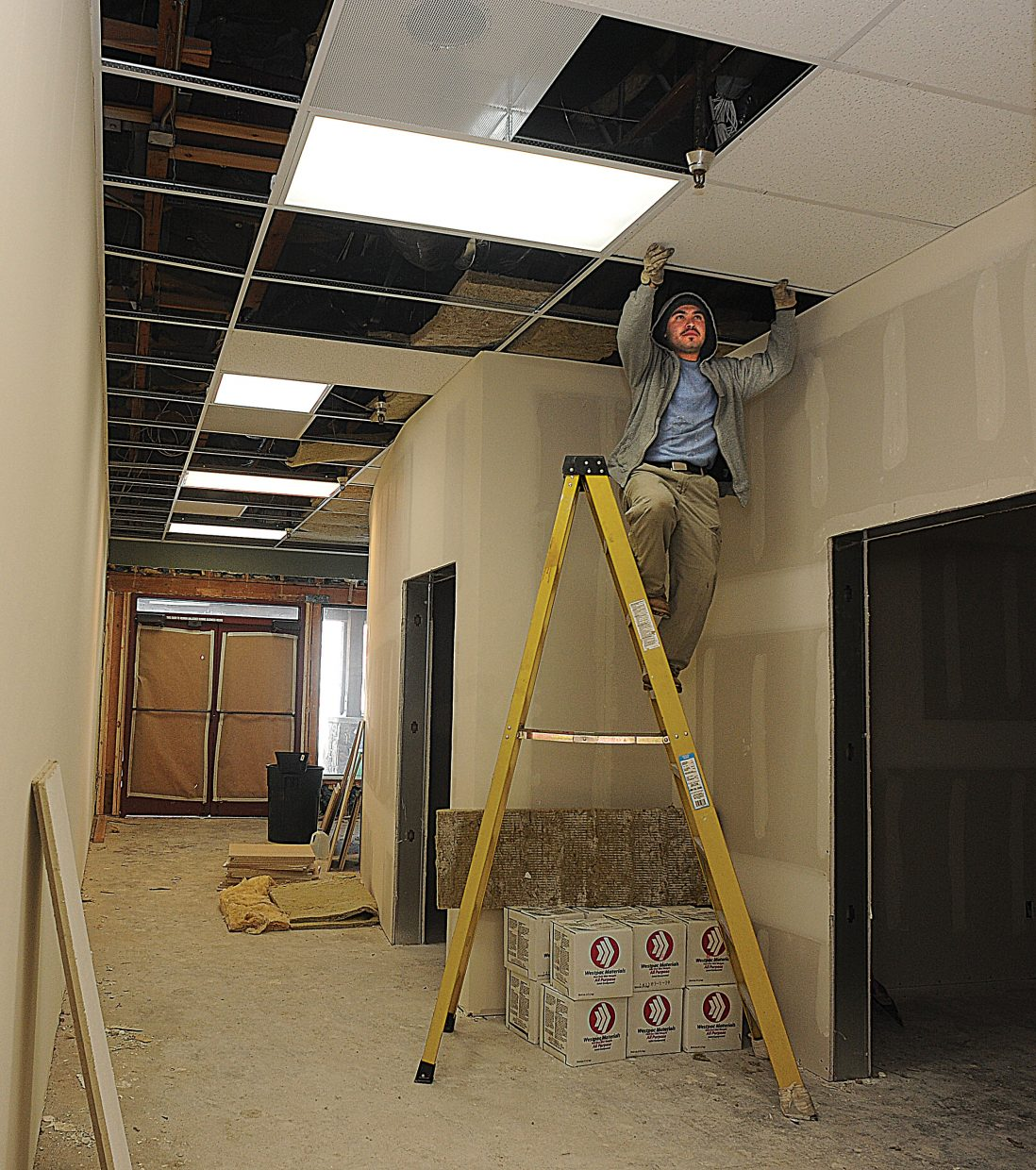 Construction worker Gerardo Lopez works on a remodeling project in a space where Sundance Studio will be expanding its operations.