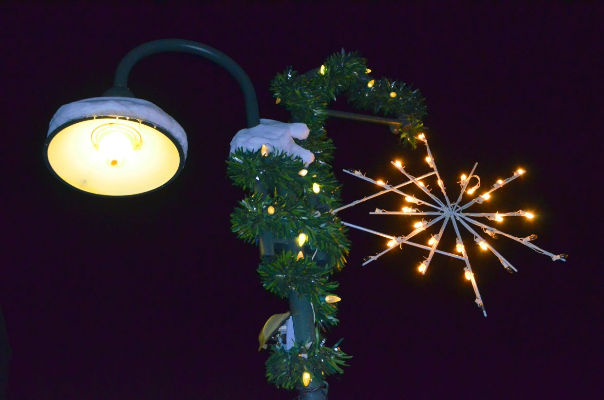 One of many snowflake lights found along Yampa Avenue provides downtown holiday cheer.