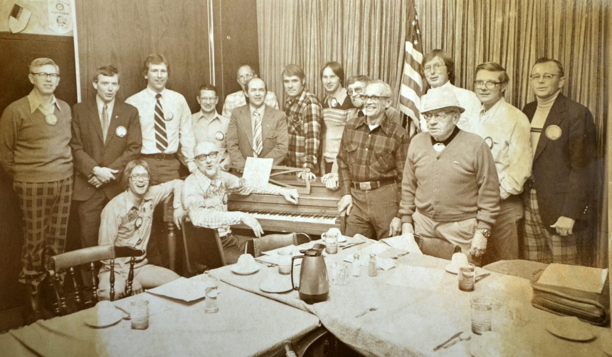 Members of the Steamboat Springs Kiwanis Club gather around Ragtime Dollar Bill Mayhercy and the piano during a February 1979 meeting. The club announced this month its membership had dwindled to a half dozen people and it was relinquishing its charter.