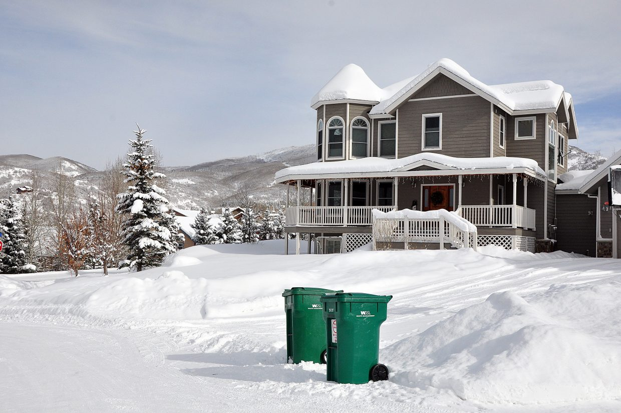 Trash and recycling containers sit outside a home in Steamboat Springs on Monday afternoon. Under a new city ordinance that could get final approval next week, many residential trash customers could have to spend anywhere from $200 to $350 on wildlife-resistant trash containers.