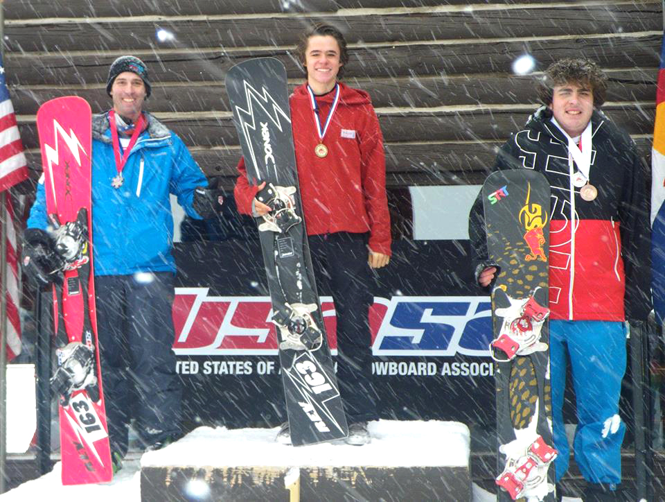 Billy Winters stands atop a Steamboat-filled podium Sunday after winning an Alpine snowboard race at Howelsen Hill in Steamboat Springs. He's joined by second-place Everett McEwan, who also won a race, and third-place Garrett Denney, who was third and second in the day's two races.
